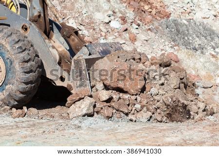 The bulldozer working In coal mines. - stock photo