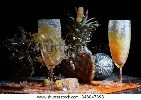 The bullet hit the glass with pineapple juice through