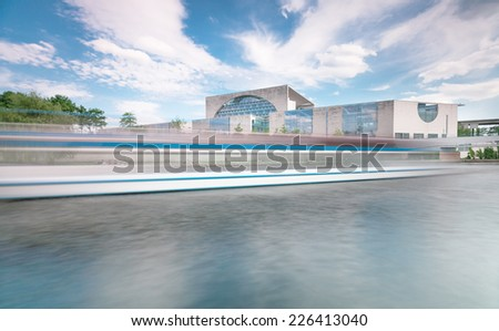 The Bundeskanzleramt (Kanzleramt) with dynamic on spree river, famous landmark in Berlin - Chancellery is the seat of the German federal government and the residence of the German Bundeskanzler - stock photo