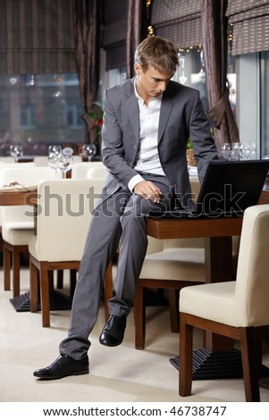 The business man at restaurant with the laptop - stock photo