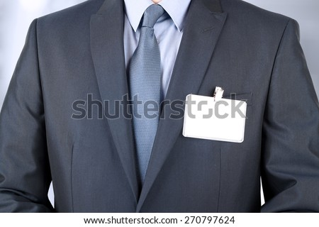 The business man in a modern suit with  a  Blank Badge - stock photo