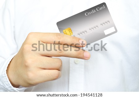 The business man in white shirt 's showing the gray credit card. - stock photo