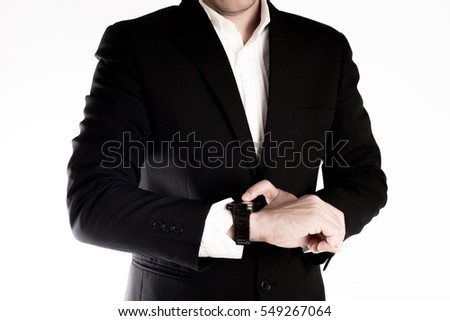 The business man point his finger to the watch on white background