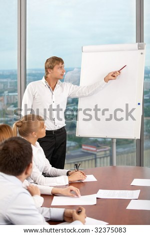 The business man shows something on a board at conference - stock photo