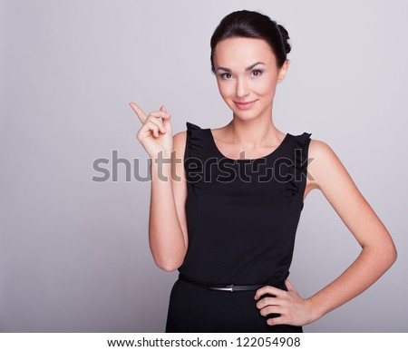 the business woman points a finger up - stock photo