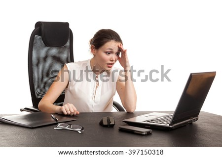 the business woman sits at office table with the laptop