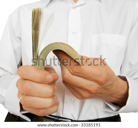 The businessman counts money in hands. isolated on white