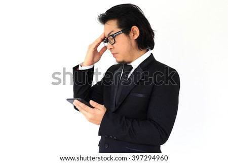 The businessman feeling stressed after reading the message from a smartphone.
