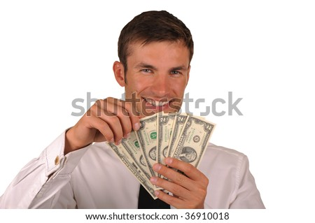 The businessman holds in hands of two dollar denominations and joyfully smiles isolated on a white background