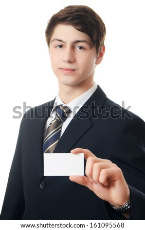 The businessman in a business suit with a visiting card