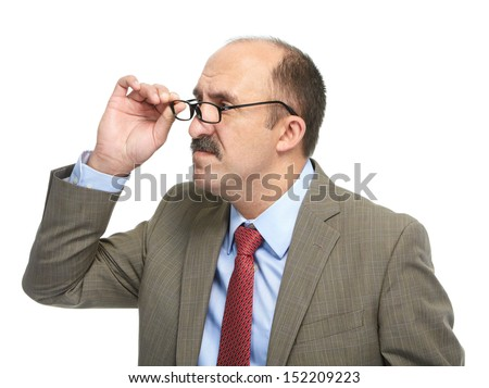 The businessman in spectacles on a white background