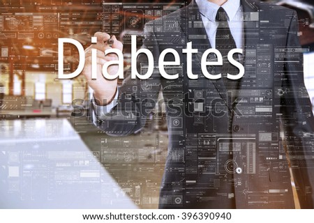 the businessman in the office is writing on the transparent board: Diabetes - stock photo