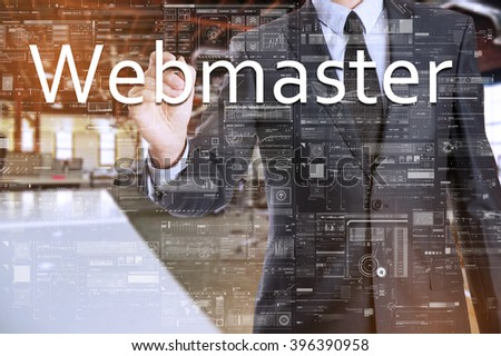 the businessman in the office is writing on the transparent board: Webmaster - stock photo