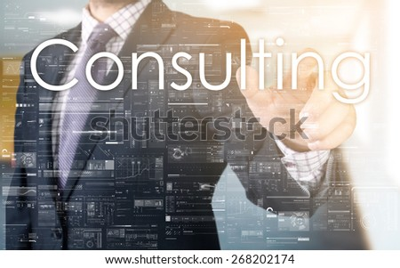 the businessman is choosing Consulting from touch screen - stock photo