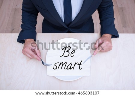 the businessman is preparing to consume things which he needs : Be smart . Concept of reaching needed things by consuming them. Features expected by the employer from future employees.