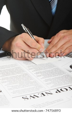 The businessman is signing