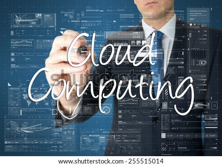 the businessman is writing Cloud Computing on the transparent board with some diagrams and infocharts - stock photo