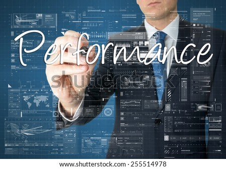 the businessman is writing Performance on the transparent board with some diagrams and infocharts - stock photo