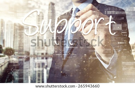 the businessman is writing Support from touch screen - stock photo