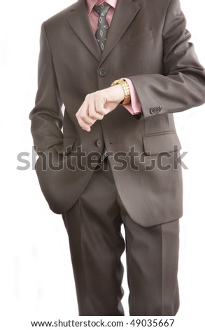 the businessman looks at the clock