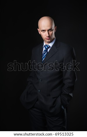 The businessman on a black background - stock photo