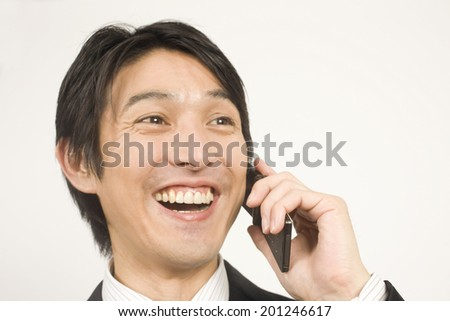 The businessman talking on a mobile phone