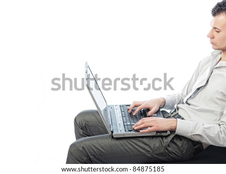 The businessman typing text on the laptop