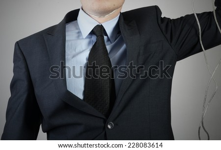 the businessman wants to commit suicide with the help of the cable from the computer - stock photo
