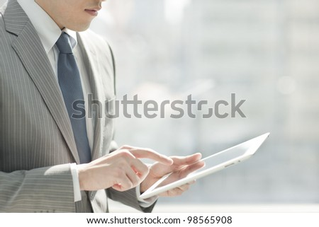 The businessman who looks at scenery - stock photo