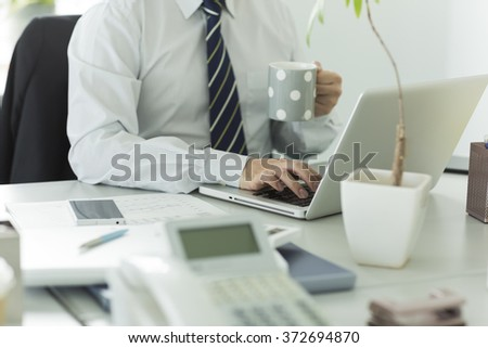 The businessman who operates a note PC - stock photo