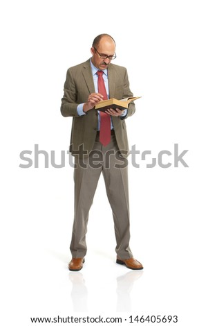 The businessman with the book on a white background