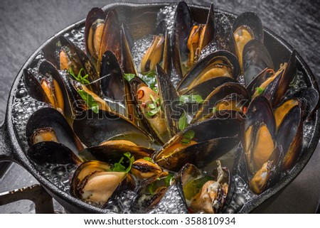 The butter wine steaming of the mussel is Spanish-style - stock photo