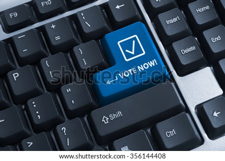 The button vote now on computer keyboard - stock photo