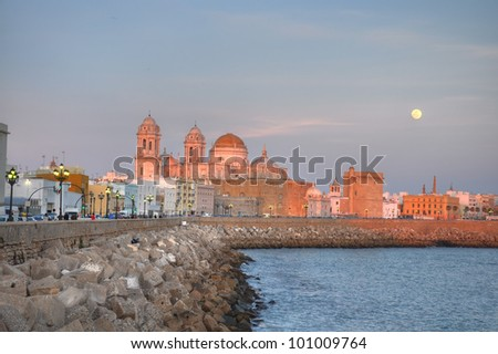 The Cadiz cathedral surprised at sunset. It sits on the site of an older cathedral, completed in 1260, which burned down in 1596. - stock photo
