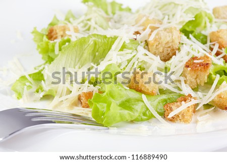 The Caesar salad prepared on the classical recipe - stock photo