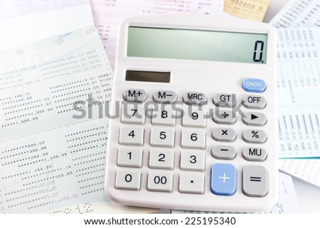 The calculator is used to calculate the numbers. - stock photo