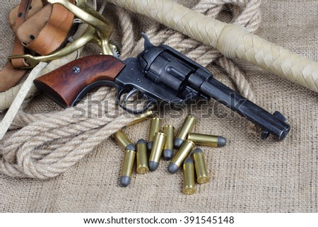 The .45 caliber revolver with western accessories  - stock photo