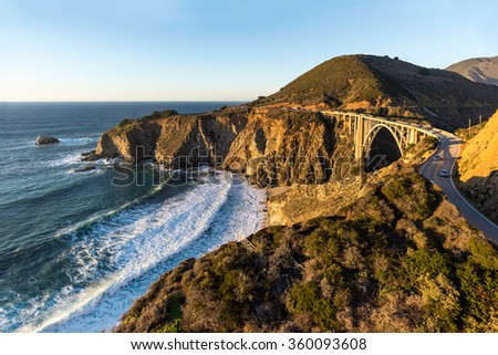 The California coast glows in late afternoon sun in this aerial view of the Pacific Coast Highway. - stock photo