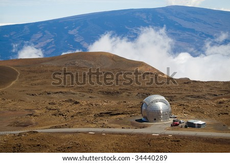 The Caltech Submillimeter Observatory atop the Mauna Kea volcano in Hawaii Big Island. - stock photo