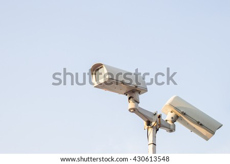 The camera cctv security and white sky background