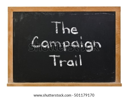 The campaign trail written in white chalk on a black chalkboard isolated on white