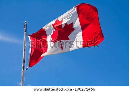 The Canadian flag, flapping in the wind