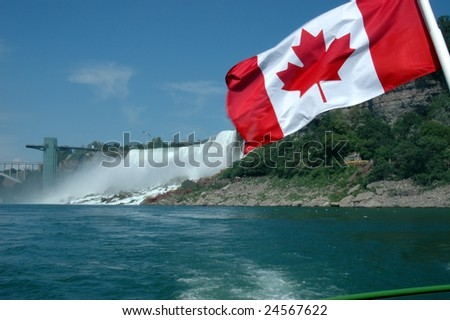 The Canadian flag on a boat in the Niagara Falls gorge - stock photo
