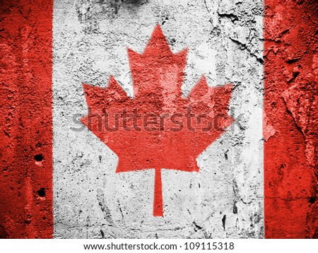 The Canadian flag painted on grunge wall - stock photo