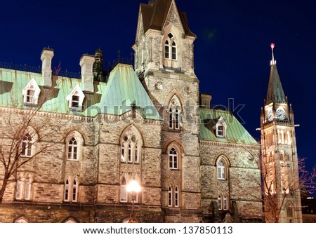 The Canadian Parliament West Block and Clock Tower in Ottawa at dusk.