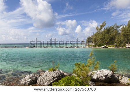 The canal that separates Coral and Silver Point beaches on Grand Bahama Island. - stock photo