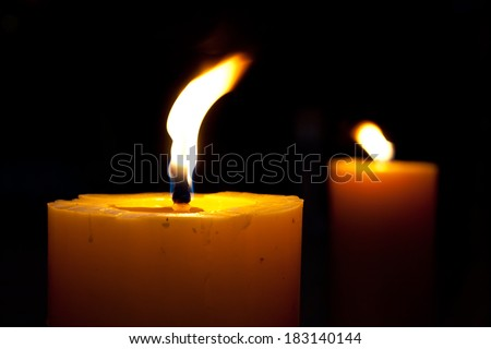 the candles flame in the dark closeup - stock photo