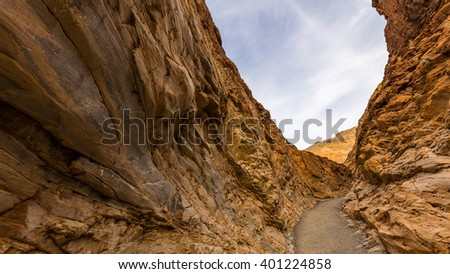 The canyon narrows dramatically to a deep slot cut. Mosaic Canyon, Death Valley National Park, California - stock photo