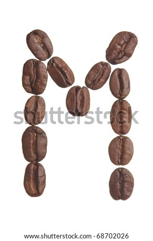 The capital letter M spelled in coffee beans, isolated on a white background. Macro resolution.