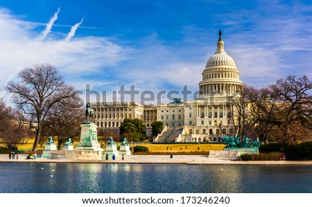 The Capitol and Reflecting Pool in Washington, DC. - stock photo